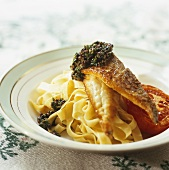 Grilled fish fillet with salsa verde, tomato & ribbon pasta