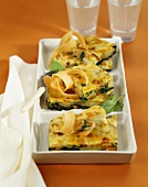 Three pieces of spinach and potato tortilla