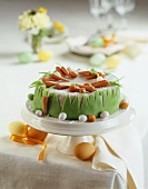 A carrot cake on a table laid for Easter