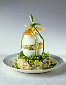 Egg stuffed with vegetable salad in mayonnaise
