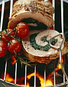 Stuffed loin of pork on barbecue rack