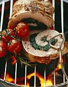 Stuffed loin of pork on barbecue rack