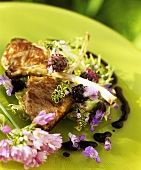 Lamb cutlets with edible flower salad