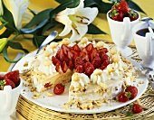 Buttercream cake with strawberries and macadamia nuts
