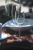 Wine- & champagne glass in front of white tableware on table