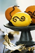 Oranges & lemon studded with cloves on a pedestal stand