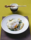 Penne with nettle and spinach sauce and poached egg