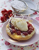 Hot cherry tart with vanilla ice cream