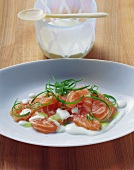 Raw salmon with green horseradish sauce and spring onions