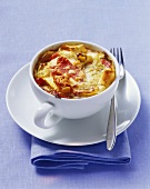 Pasta bake with white cabbage and ham in cup