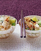 Fried rabbit fillet with peanuts on glass noodle salad