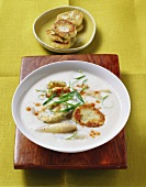 Asparagus cream soup with ricotta cakes and chives