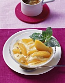 Poached peach with Grappa sabayon and passion fruit sauce