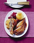Roast Barbary duck with marzipan apple, red cabbage & dumpling