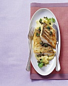 Fried zander with capers on mashed potato and celeriac