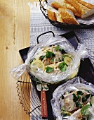Fish fillets with pesto herbs cooked in roasting bags