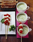 Potato and basil soup and mozzarella and tomato skewers