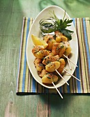 Potato and salmon skewers with rocket pesto