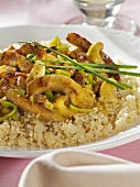Curried meat with cashew nuts on couscous