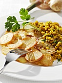 Red lentil risotto with fried potatoes