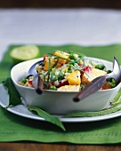 Fruity rice and pea salad with curry and lime
