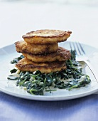 Salmon cakes on spinach