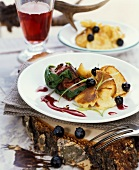 Venison steak with chopped pancakes and red wine sauce