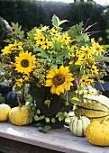Autumnal arrangement of sunflowers, grasses, foliage etc.