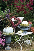 Autumn arrangement centred around garden chair