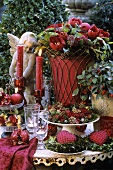 Wintry decoration in red and green on table in garden