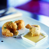 Deep-fried prawns in batter with sweet & sour pineapple sauce