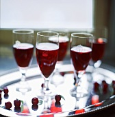 Kir royal in glasses on silver tray
