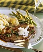 Veal escalope with limoncello sauce, artichokes & asparagus