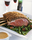 Rack of veal with chestnut crust on peas