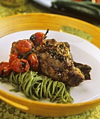 Spicy veal cutlet with tarragon, green noodles & tomatoes