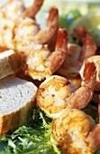 Shrimp skewers on salad