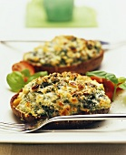 Baked potatoes with cheese and spinach crust