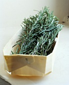 Sprigs of rosemary in a woodchip basket