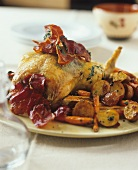 Roast chicken with bacon and roast potatoes
