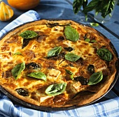 Hearty pumpkin tart with sheep's cheese, onions and basil