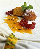 Pumpkin fritters with sauce and redcurrants
