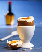 Boiled egg with top cut off in eggcup