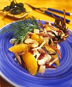 Seafood salad with orange segments