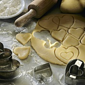 Cutting out heart-shaped biscuits