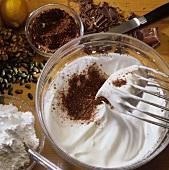 Making chocolate meringue or chocolate macaroons