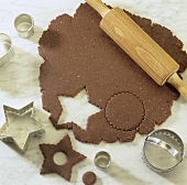 Cutting out gingerbread biscuits (to hang on the Xmas tree)