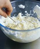 Folding beaten egg white into vanilla cream