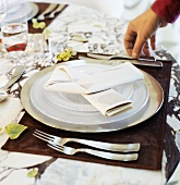 Place-setting in shades of white and brown
