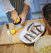 Preparing Baltic herring: squeezing a lemon