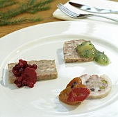 Terrine and pâté with chutneys on plate